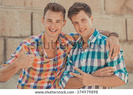 Two beautiful boyfriends in summer clothes outdoor portrait