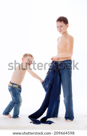 two beautiful boys with jeans, isolated on white background - stock photo