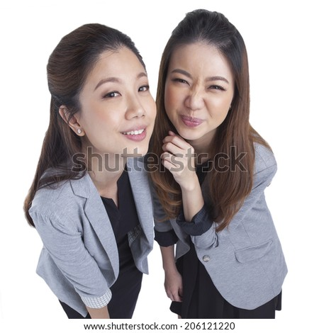 Two beautiful businesswomen having a happy post take a photo isolated on white background