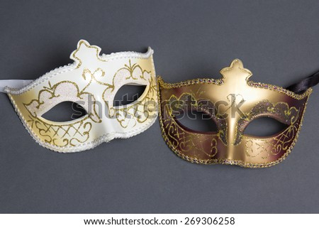 two beautiful carnival masks on grey background - stock photo