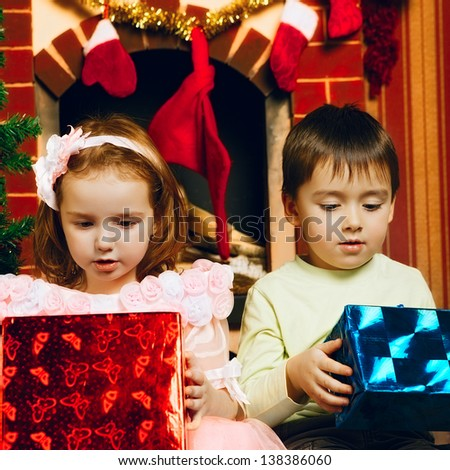 two beautiful child with gift at new year's eve - stock photo