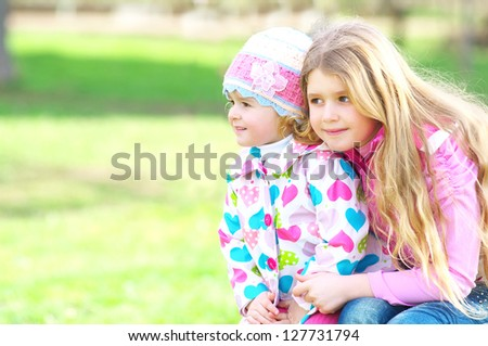 Two beautiful children in the park - stock photo