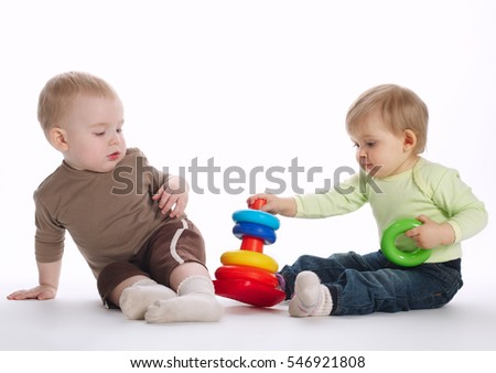 two beautiful children playing with pyramide
