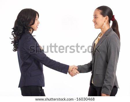 two beautiful colleague shaking their hands - stock photo