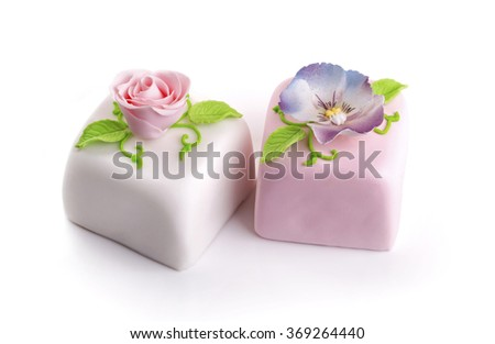 two beautiful decorated marzipan cakes isolated on white - stock photo