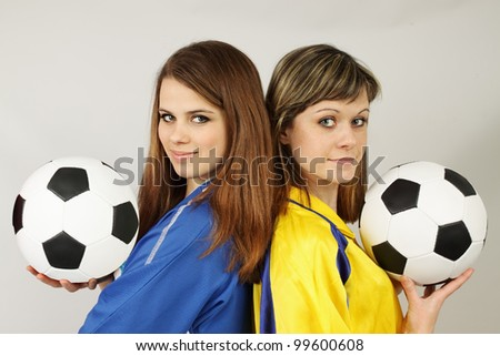 two beautiful football fans hold the balls - stock photo