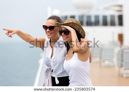 two beautiful friends enjoying cruise ship - stock photo