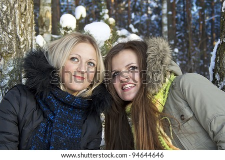 two beautiful girls in the winter in nature - stock photo