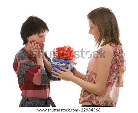 Two beautiful girls with a gift box. Isolated on white.
