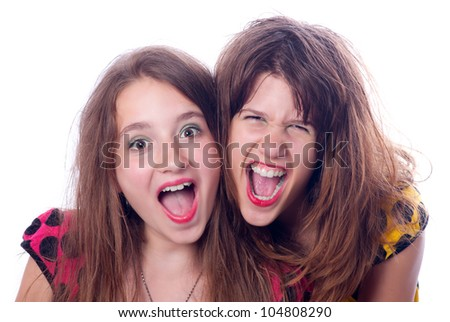 Two beautiful happy teenage girls screaming isolated on white.
