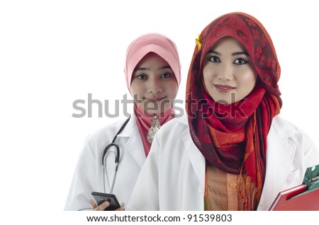 two beautiful medical doctor holding phone and note book isolated on white background - stock photo