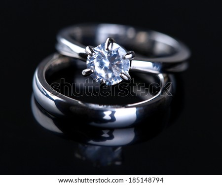 Two beautiful rings isolated on black - stock photo