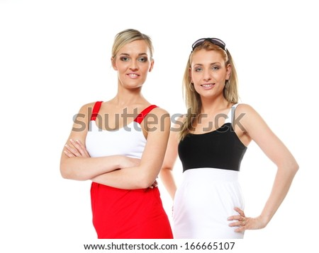 Two beautiful sexy crazy women in summer clothes. Studio shot isolated on white background