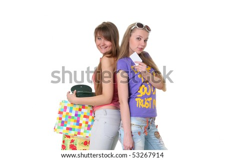 Two beautiful smiling young girls who are going shopping on a white background