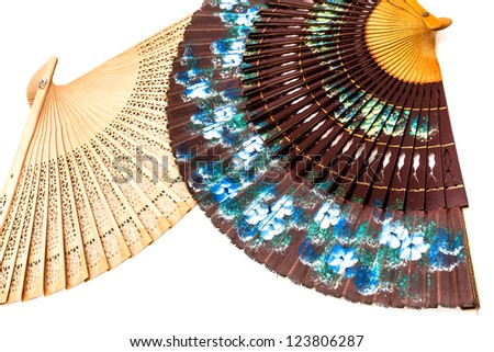 Two beautiful spanish fan on a white background