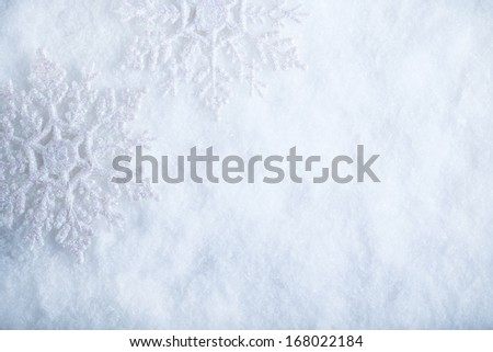 Two beautiful sparkling vintage snowflakes on a white frost snow background. Winter and Christmas concept.  - stock photo