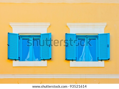 Two beautiful windows from an old house in Kos island in Greece - stock photo