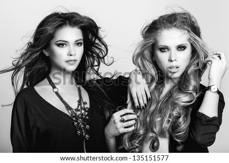 two beautiful woman with healthy long hair. Wavy Hair. Hairstyle. Not isolated on background.