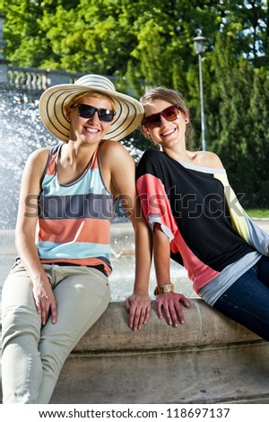 Two  beautiful woman with sunglasses