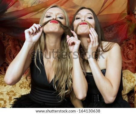 Two beautiful women are having fun - stock photo