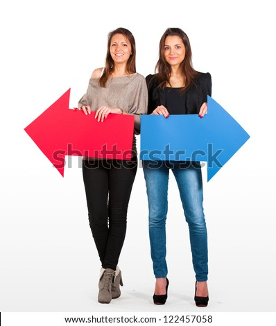 Two beautiful women holding red and blue arrow, left and right - stock photo