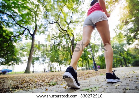 Two beautiful women jogging in park and keeping their bodies in shape