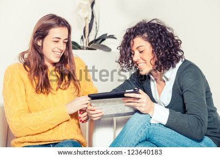 Two Beautiful Women with Digital Tablet