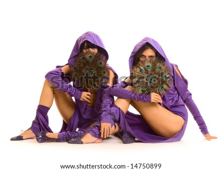 two beautiful women with fun sitting on the floor - stock photo