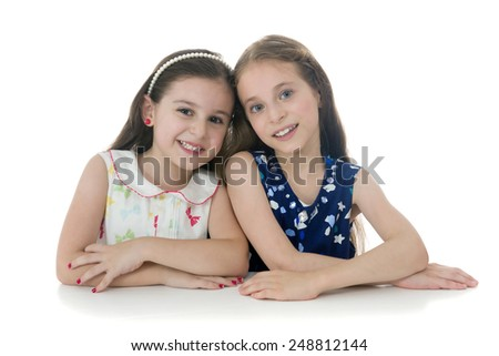 Two Beautiful Young Girls Posing for Photo Isolated on White background - stock photo