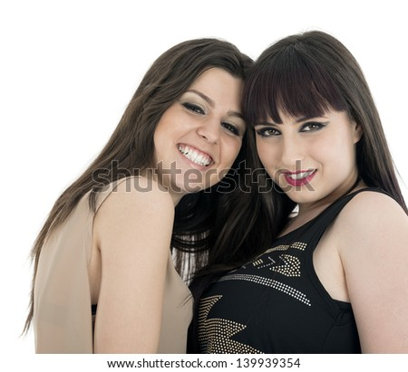 Two beautiful young sensual glamour women standing together over white background - stock photo