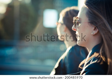 two beautiful young women in the city - stock photo