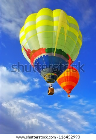 Two beauty balloons flying in sunny blue sky - stock photo