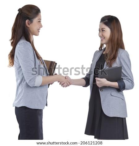Two beauty businesswomen handshaking smiling on white background - stock photo