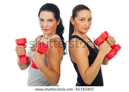 Two beauty fitness women holding dumb bell isolate don white background - stock photo