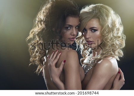 Two beauty ladies in a dream scenery  - stock photo