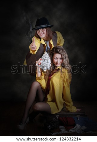 Two beauty swindler girls with case of money - stock photo