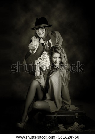 Two beauty swindler girls with case of money. Retro style - stock photo