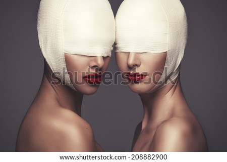 Two beauty woman with bandage - stock photo