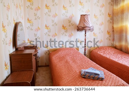 Two beds in motel room  - stock photo