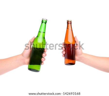 Two beer bottles and three hands isolated on white - stock photo