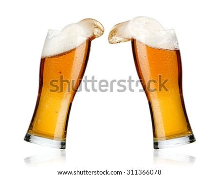 Two beer glasses up - stock photo