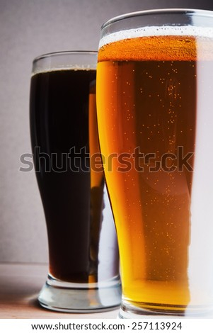 Two beer mugs on wood table