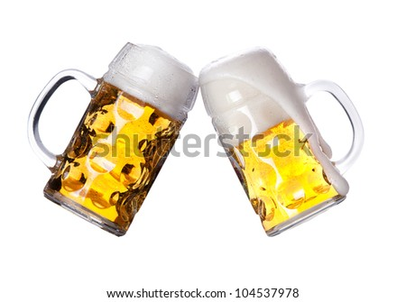 two beers making a toast on white backgroound - stock photo