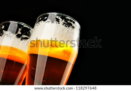 Two beers with froth with copyspace - stock photo