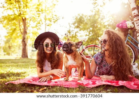 Two best friends and cute dog . Selective focus, depth of field   - stock photo