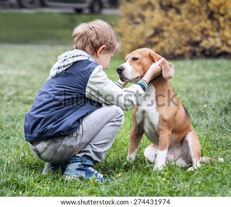 Two best friends - boy and his dog - stock photo