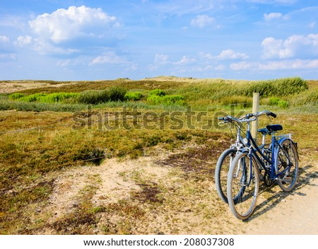 Two bicycles in countryside. Brittany, France. The concept of romance, love and simple everyday life. - stock photo