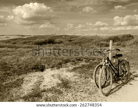 Two bicycles in countryside. Brittany, France. The concept of romance, love and simple everyday life. Aged photo. Sepia. - stock photo