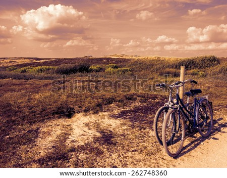 Two bicycles in countryside. Brittany, France. The concept of romance, love and simple everyday life. Toned photo. - stock photo