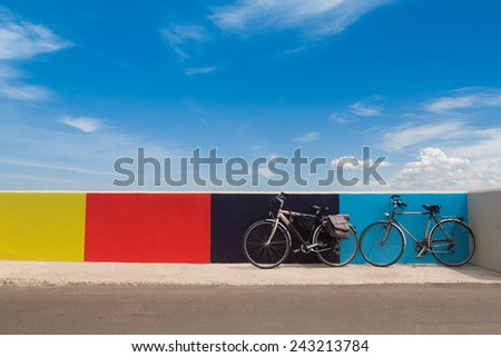 Two bicycles on the Italian embankment. Summer time. - stock photo